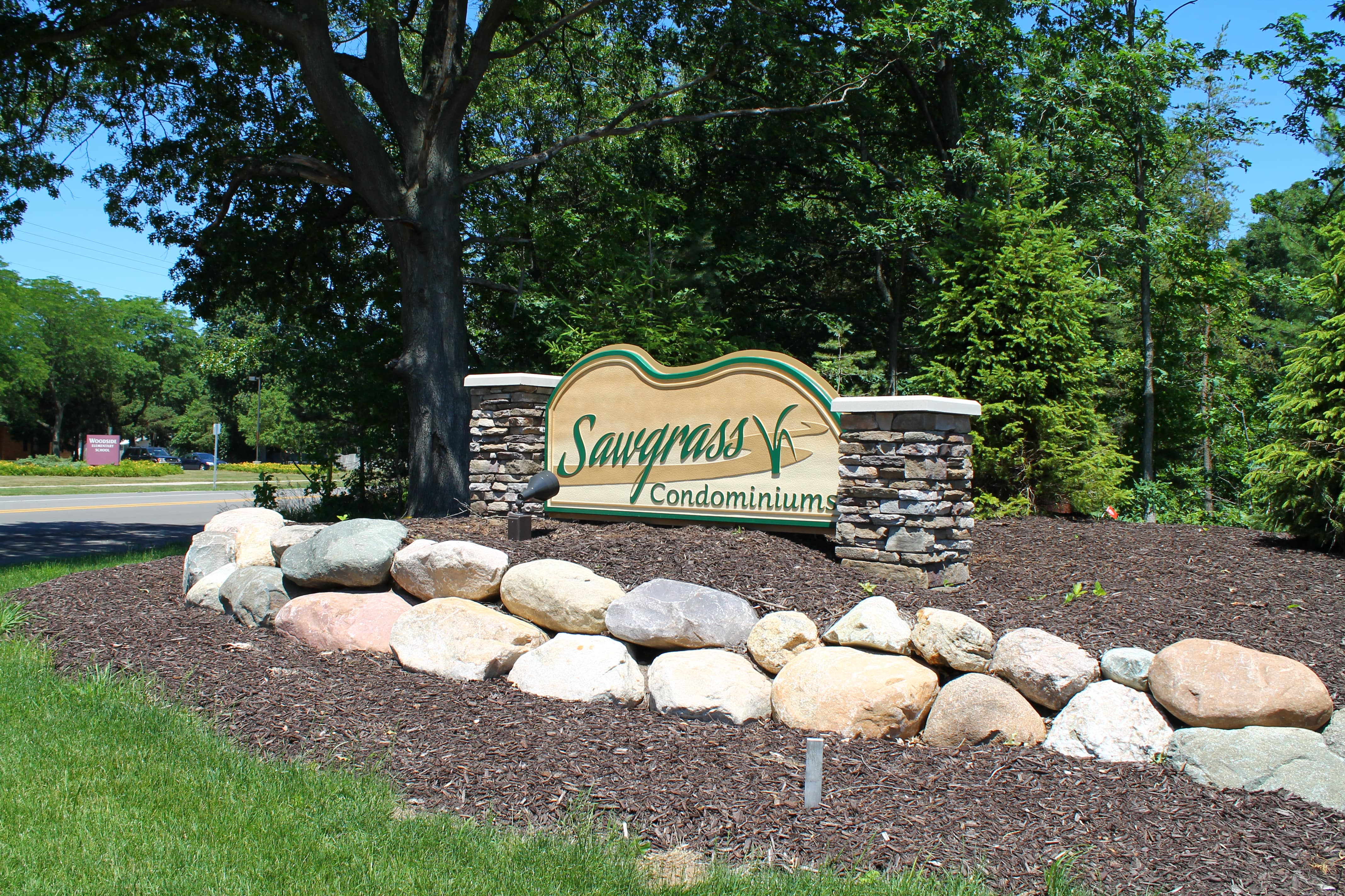 Front Entrance sign of Sawgrass Condominiums