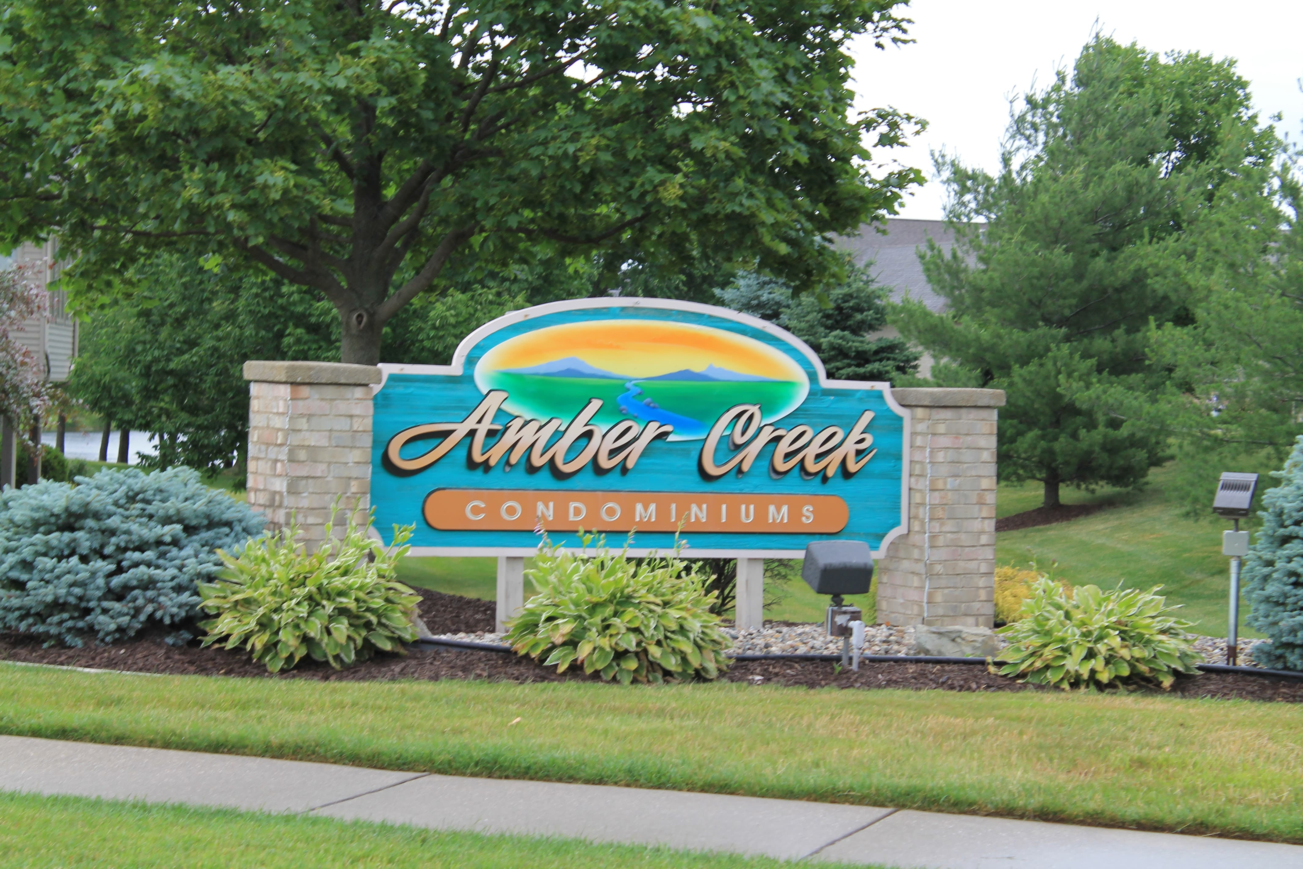Entrance sign of Amber Creek Condominiums